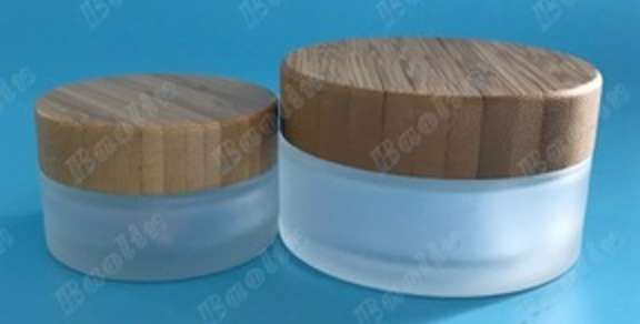 0c1258428fc5 100ml frosted cosmetic glass jar with bamboo lid